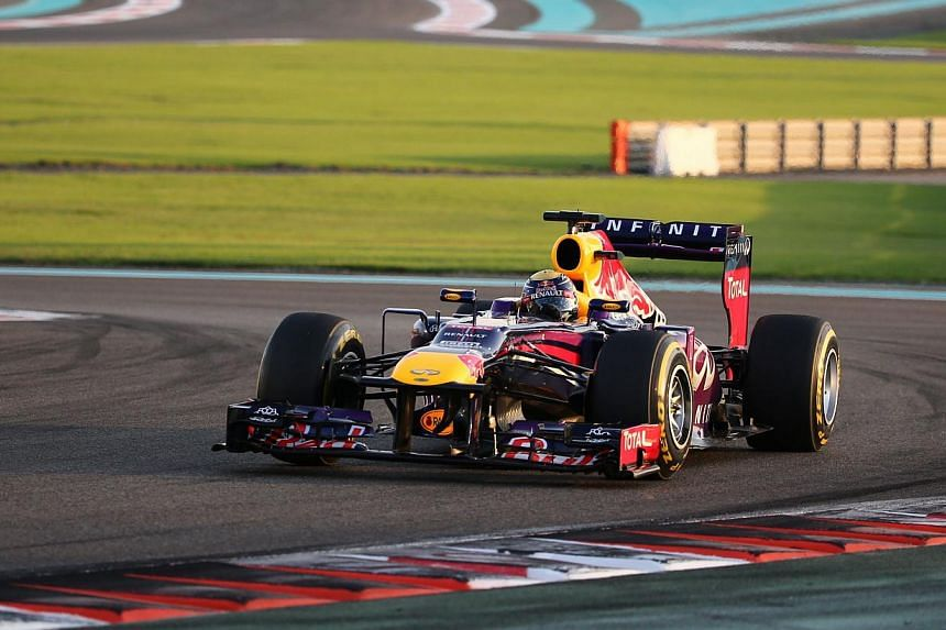 Red Bull Racing's Australian driver Mark Webber drives at the Yas Marina circuit in Abu Dhabi on Nov 3, 2013, during the Abu Dhabi Formula One Grand Prix.Webber has no intention of coasting when he calls time on his 12-year career in Formula On