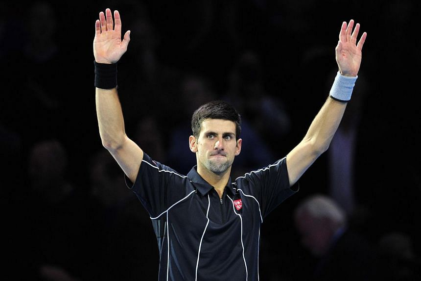 Serbia's Novak Djokovic celebrates beating Argentina's Juan Martin Del Potro during their group B singles match in the round robin stage on the fourth day of the ATP World Tour Finals tennis tournament in London on Thursday, Nov 7, 2013. Djokovi