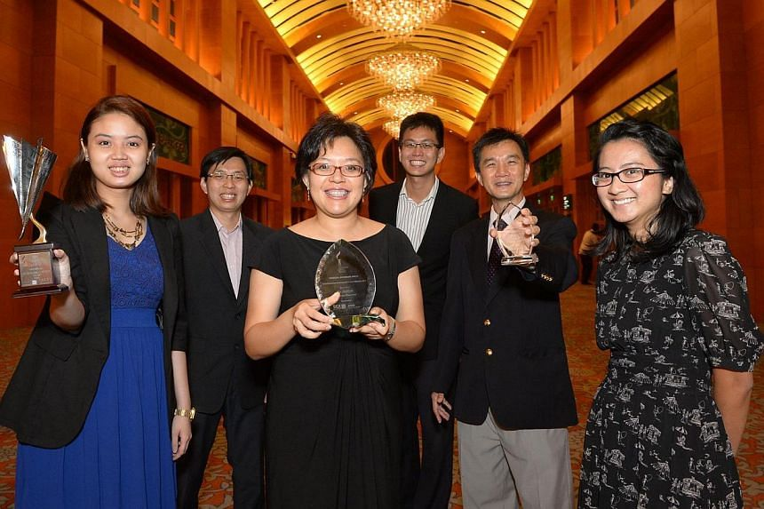 Straits Times Money Desk editor Lee Su Shyan (third from left) with journalists and correspondents (from left) Rachel Scully, Alvin Foo, Jonathan Kwok, Goh Eng Yeow and Yasmine Yahya. Seven Singapore Press Holdings (SPH) journalists have receive