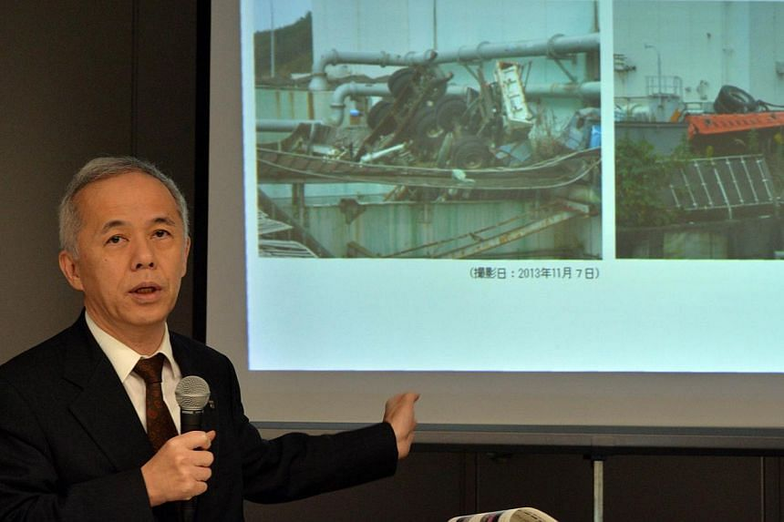 Tokyo Electric Power Co (Tepco) president Naomi Hirose announcing the new safeguard at the crippled Fukushima No. 1 nuclear plant at the company's headquarters in Tokyo on November 8, 2013 as radio active water leaked from contermination tanks. Tepco
