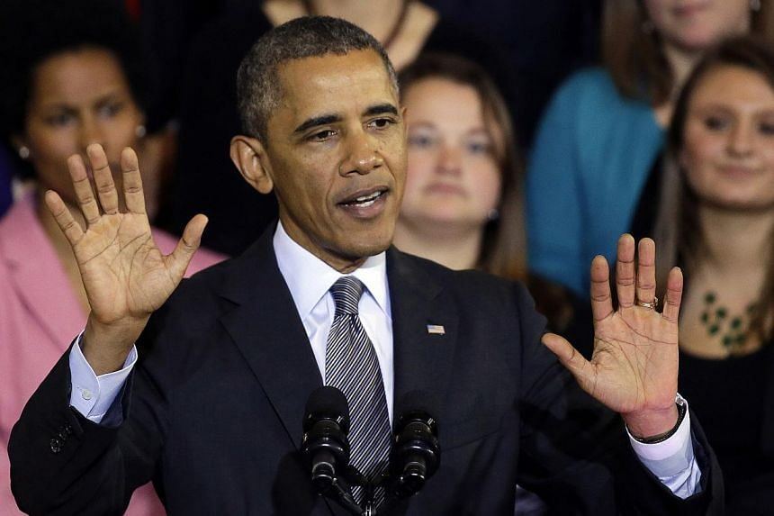 """President Barack Obama speaks at Boston's historic Faneuil Hall about the federal health care law on Oct 30, 2013.Mr Obama said on Thursday he was """"sorry"""" for Americans who had insurance plans cancelled because of his health care law, even thou"""
