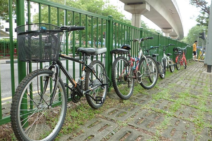 Pupils of a primary school in Sengkang chain their bicycles to railings as they are not allowed to park them in the school. Such attitudes need to change so people are encouraged to use bicycles for transport.