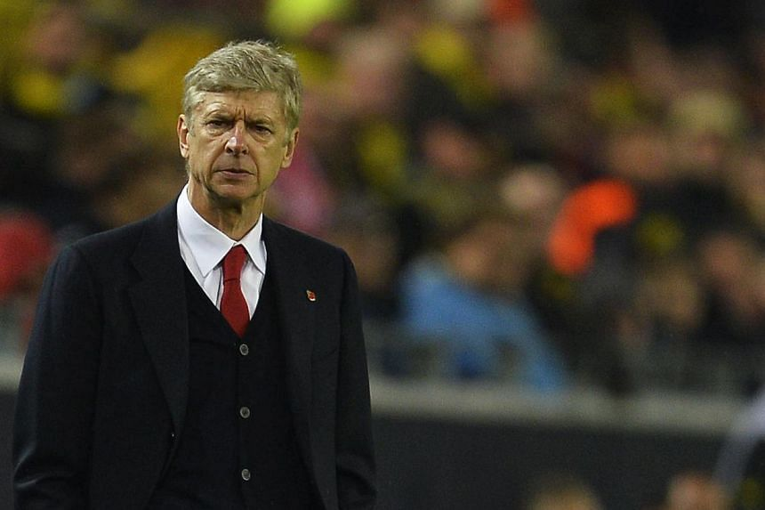 Arsenal head to Manchester United tomorrow with manager Arsene Wenger (above) talking of strange times and serenity. -- PHOTO: AFP