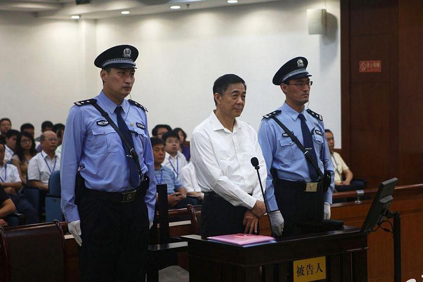 Disgraced Chinese politician Bo Xilai (centre) stands trial inside the court in Jinan, Shandong province on Aug 22, 2013, in this file photo released by Jinan Intermediate People's Court.Supporters of Bo, who has been jailed for corruption, hav