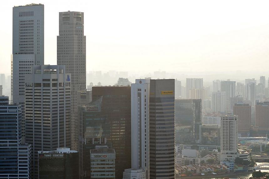 The Central Business District (CBD) skyline on July 9, 2011.Six new bus services that will take commuters from housing estates to the CBD via expressways will be launched progressively from the first half of 2014. -- ST FILE PHOTO:ALPHONS
