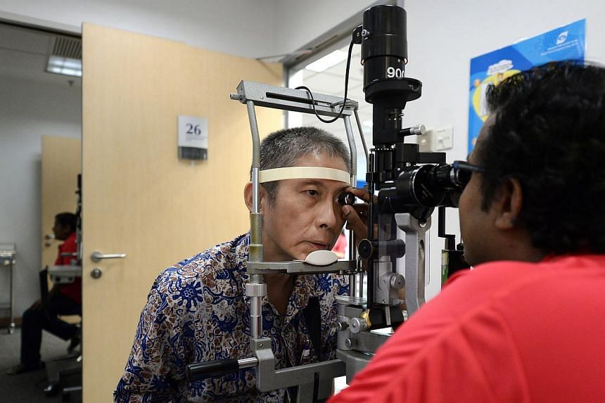 Close to 2,200 elderly residents received free eye screenings on Saturday as part of the 14th National Eye Care Day. Organised by the Singapore National Eye Centre (SNEC), the screenings were conducted at four eye centres island-wide. -- ST PHOT