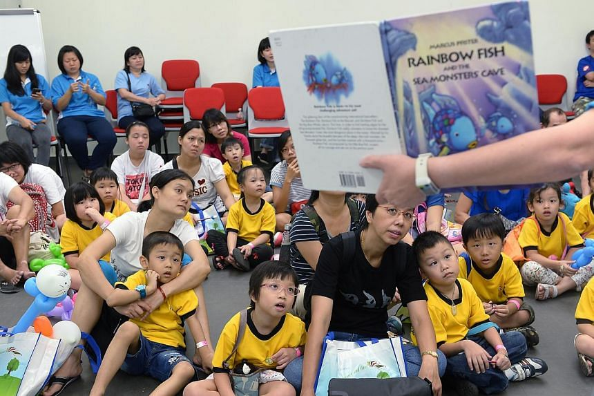 Children and their parents from theChinese Development Assistance Council (CDAC)at KidsREAD Day.The CDAC is looking at expanding its kidsREAD programme next year, by getting each child to read 160 books in four years. -- ST PHOTO:&n