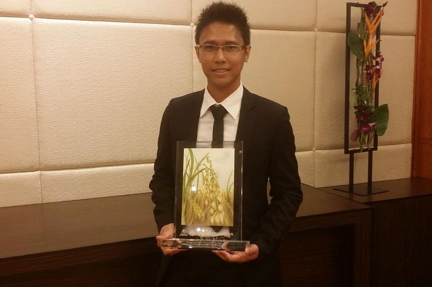 Teacher Muhammad Irwan Jamal (above) allows students to use social networking sites like Facebook and Instagram in class - and it has won him an award.-- ST PHOTO: RACHEL AU-YONG