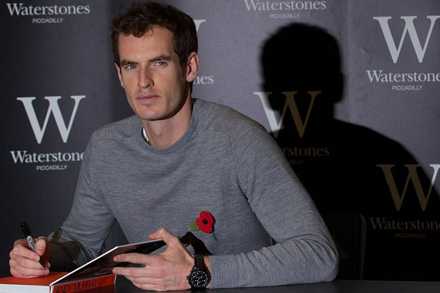 """Andy Murray poses for pictures as he launches his new book Seventy-Seven: My Road To Wimbledon Glory at a bookstore in London, on Nov 6, 2013. TheWimbledon champion on Friday blasted Viktor Troicki and Marin Cilic as """"unprofessional"""" after both"""