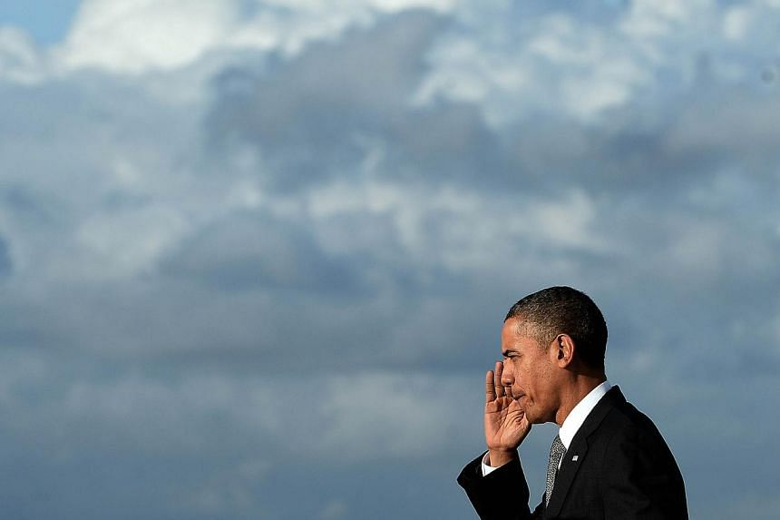 US President Barack Obama disembarks from Air Force One at Miami International Airport in Miami, Florida, on Nov 8, 2013.Mr Obama on Friday accused Republicans of slamming on the brakes every time the US economy is set to take off, as he cheere