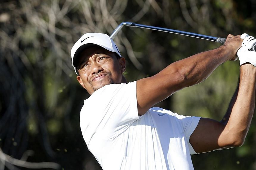 Tiger Woods tees off on the 14th hole during the second round of the inaugural Turkish Airlines Open in the south west city of Antalya Nov 8, 2013.European No.1 Henrik Stenson's drive to extend his Race to Dubai lead is under threat after Woods