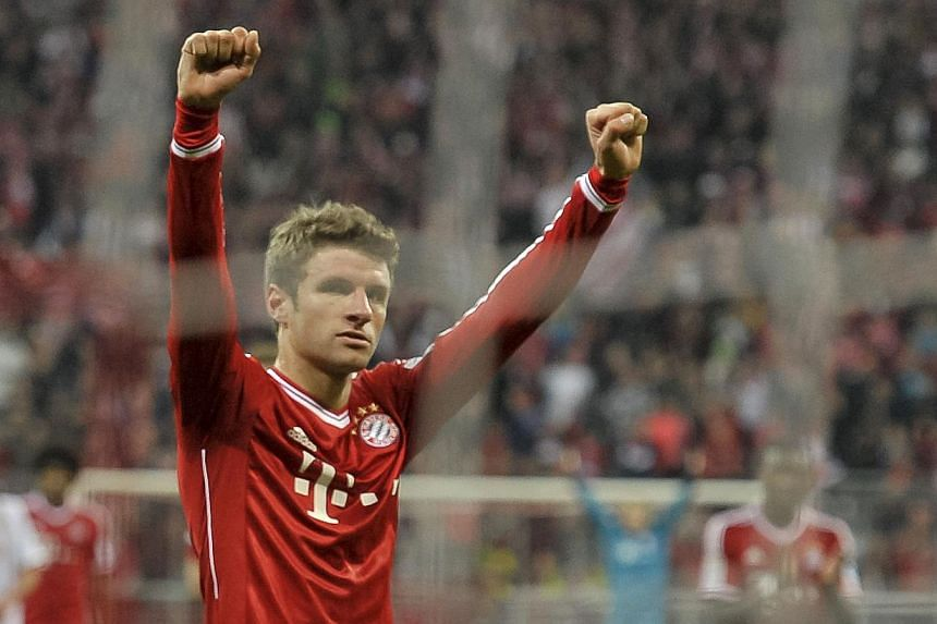 Bayern Munich's German striker Thomas Mueller celebrates his goal during Germany's first division Bundesliga football match FC Bayern Munich vs FC Augsburg in the southern German city of Munich on Nov 9, 2013. Bayern set a new record for the longest