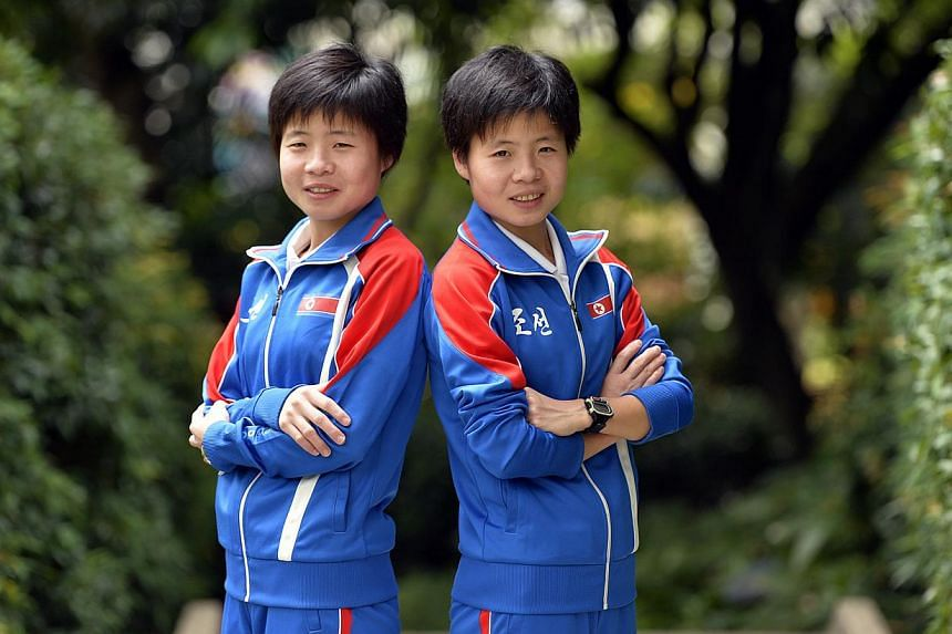 North Korea's Kim Hye Song (left) and Kim Hye Gyong dominated Sunday morning's Great Eastern Women's Run as expected, with the 20-year-old twin sisters taking the top two spots in the half-marathon (21.1km) event. -- ST PHOTO: DESMOND FOO