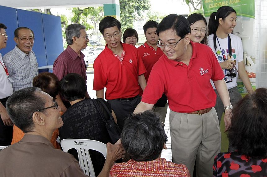 """Education Minister Heng Swee Keat at the launch of the """"Eating Well in Your Golden Years"""" programme at Kovan Hub, a health screening project by the North East Community Development Council (CDC) and Paya Lebar Active Aging Committee to help senior ci"""