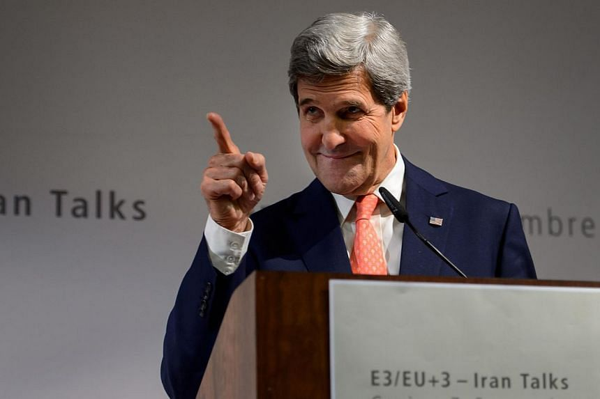 """United States Secretary of State John Kerry gestures during a press conference closing three days of talks on Iran's nuclear programme, on Nov 10, 2013 in Geneva. The US is """"not blind, and I don't think we're stupid"""" in nuclear talks with Iran, Mr Ke"""