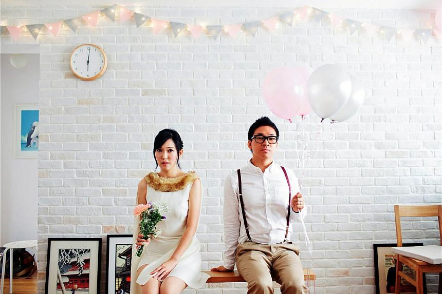To deocorate their flat for the wedding, Ms Chia Sin Nee and Mr Larry Ho spent less than $50 on fairy lights and paper to make bunting. -- PHOTO: IVAN TAN