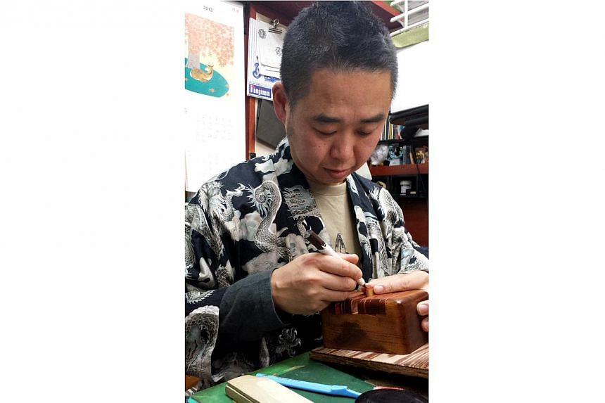 In a small, non-descript underground store in the Shibuya shopping and entertainment district, Mr Hideki Arami is hard at work carving a hanko, or seal, by hand. The youthful-looking 50-year-old is working in the same shop, Todo Insho, that was start