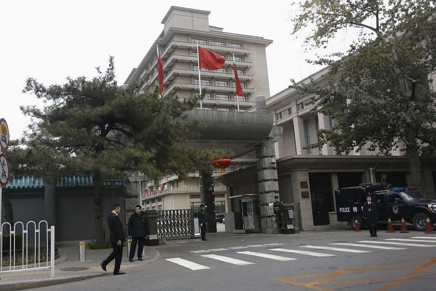 Security personnel guarding the entrance of Jingxi Hotel, the venue of the Communist Party Central Committee's Third Plenum, in Beijing, on November 9, 2013. Chinese leaders began a four-day secret meeting on Saturday to set a reform agenda for the n