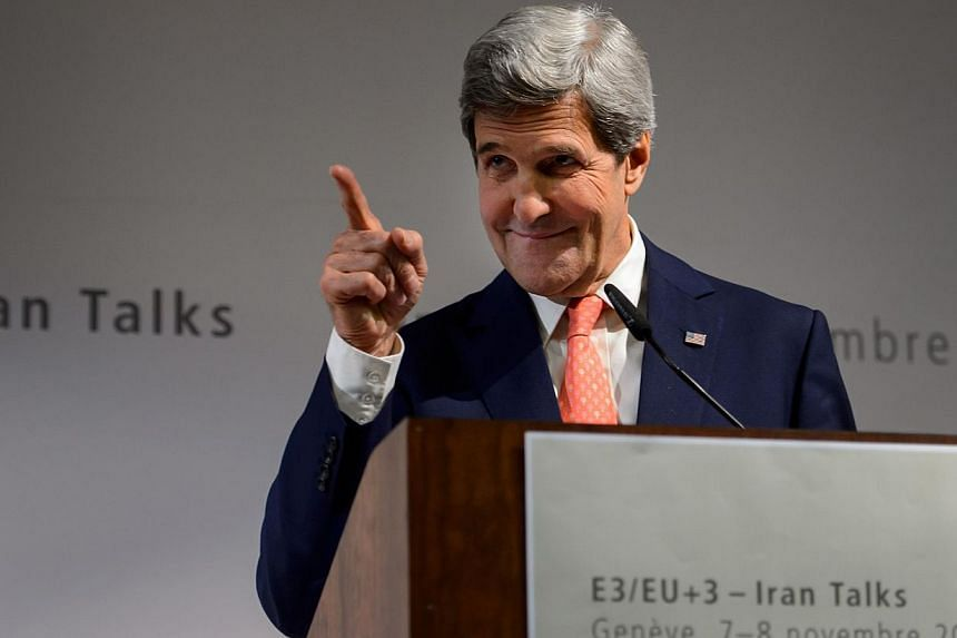 US Secretary of State John Kerry gestures during a press conference closing three days of talks on Iran's nuclear programme, on Nov 10, 2013, in Geneva. Mr Kerry said on Sunday that world powers had moved closer towards a deal during negotiations wit