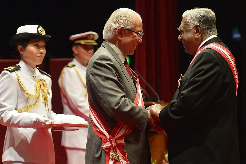 Former president S R Nathan receiving the Order of Temasek (First Class) from President Tony Tan Keng Yam last night.
