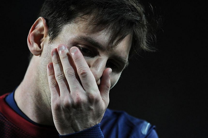 Barcelona's Argentinian star Lionel Messi (above) will be sidelined for six to eight weeks owing to a muscle tear in his left hamstring muscle, the Spanish giants said on Monday, Nov 11, 2013. -- FILE PHOTO: AFP