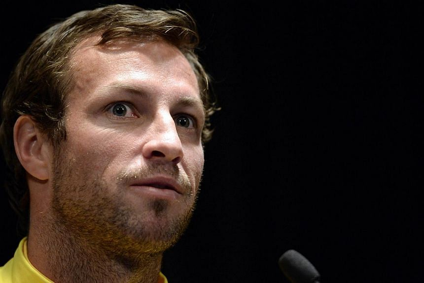 It has been a testing two months for Australia's national football team but defender Lucas Neill (above) believes the Socceroos will emerge stronger under their new manager and said next year's World Cup finals was no place to experiment with younger