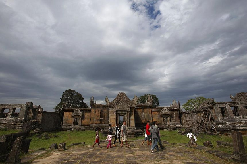 People visit the 900-year-old Preah Vihear temple on the border between Thailand and Cambodia on Sunday, Nov 10, 2013. The United Nation's top court ruled on Monday, Nov 11, 2013, that the area around a flashpoint ancient temple on the Thai bord