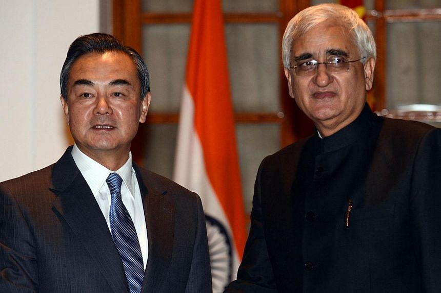 Chinese Foreign Minister Wang Yi (left) shakes hands with Indian Minister for External Affairs Salman Khurshid during a meeting in New Delhi on Nov 10, 2013. Mr Khurshid is optimistic about future relations with fellow Asian power China, with Delhi v