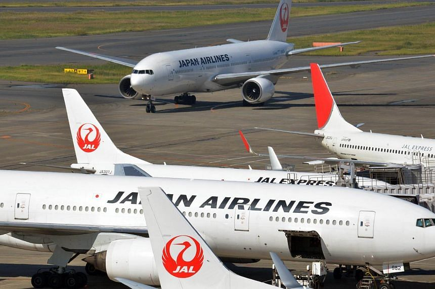 In a picture taken on Oct 30, 2013, Japan Airlines (JAL) airliners are parked at Tokyo's Haneda airport.JAL said on Monday it has reported to Boeing a possible glitch in the battery system on the 787 Dreamliner, after pilots saw an indicator wa