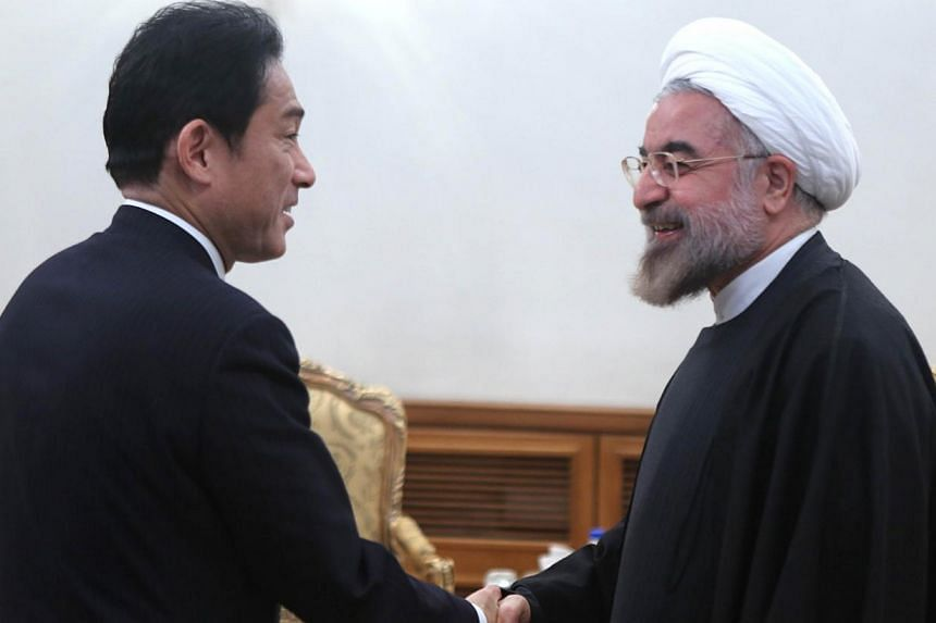 Iranian President Hassan Rouhani (right) greets Japanese Foreign Minister Fumio Kishida during meeting in Tehran on Nov 9, 2013. Japan's foreign minister on Sunday urged Iran to take further steps to reach a nuclear deal with world powers, mainly by