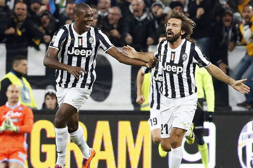 Juventus' Andrea Pirlo (right) celebrates with teammate Angelo Ogbonna after scoring a second goal against Napoli during their Italian Serie A soccer match at the Juventus stadium in Turin on Nov 10, 2013. Pirlo and Paul Pogba scored spectacular seco