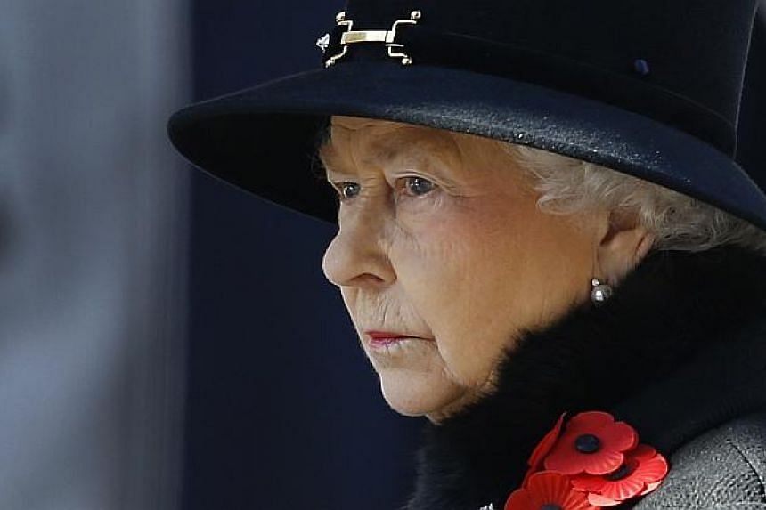 Britain's Queen Elizabeth II listens during the service of remembrance at the Cenotaph in Whitehall, London, on Nov 10, 2013. Queen Elizabeth II led Britain in paying tribute to its war dead as the country fell silent on Remembrance on Sunday. -- PHO