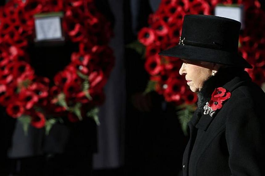 Britain's Queen Elizabeth attends the annual Remembrance Sunday ceremony at the Cenotaph in London, on Nov 10, 2013. Queen Elizabeth II led Britain in paying tribute to its war dead as the country fell silent on Remembrance on Sunday. -- PHOTO: REUTE