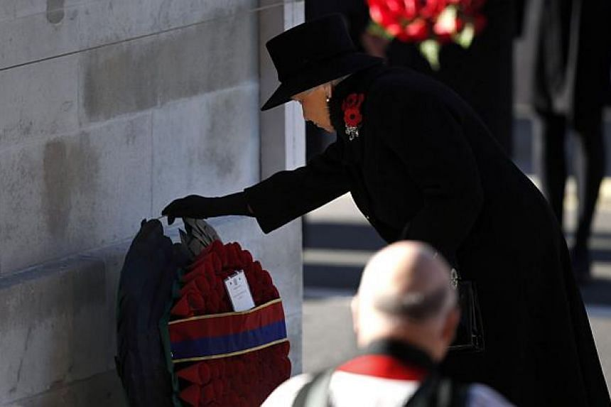 Britain's Queen Elizabeth lays a wreath at the Cenotaph during the Remembrance Sunday parade in Whitehall, London, on Nov 10, 2013. Queen Elizabeth II led Britain in paying tribute to its war dead as the country fell silent on Remembrance on Sunday.