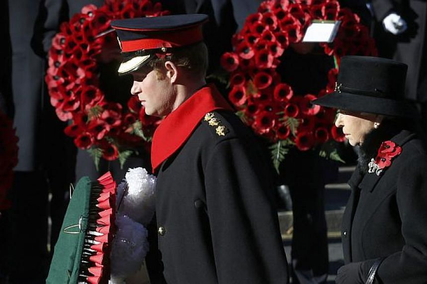 Britain's Queen Elizabeth and Prince Harry attend the annual Remembrance Sunday ceremony at the Cenotaph in London on Nov 10, 2013. Queen Elizabeth II led Britain in paying tribute to its war dead as the country fell silent on Remembrance on Sunday.