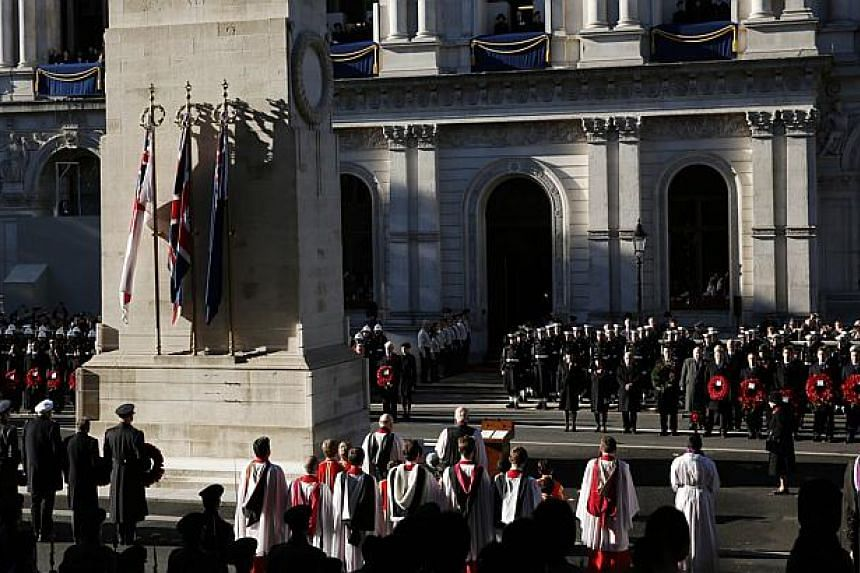 Servicemen and dignitaries pay their respects as Queen Elizabeth II stands to honour the dead during ceremonies marking Remembrance Sunday at the Cenotaph in central London on Nov 10, 2013. Queen Elizabeth II led Britain in paying tribute to its war