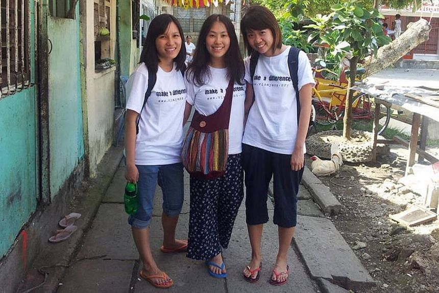From left to right: Alyssa Chee Pui Yee, Vanessa Chong Yuting, Eileen Heng Mei Ting. Three Singaporean students doing volunteer work in Tacloban, Philippines, have been uncontactable since Friday, when super Typhoon Haiyan hit the area. -- PHOTO