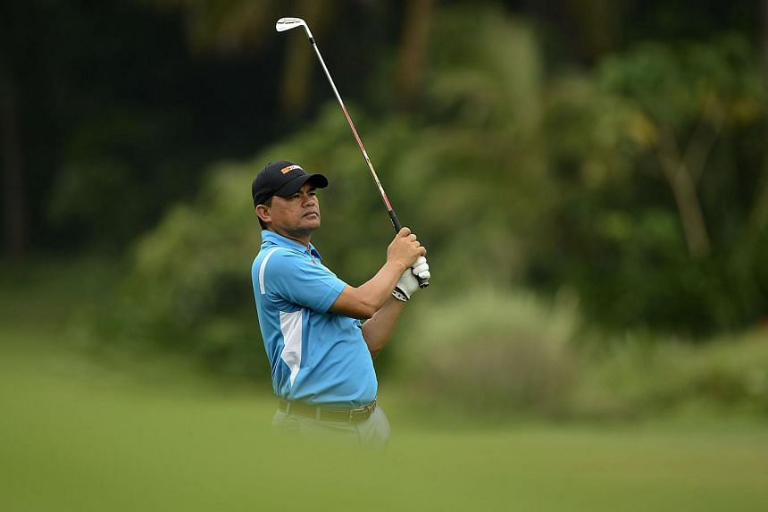 A handout photo taken on Tuesday, Nov 12, 2013, shows Frankie Minoza of the Philippines playing a shot during an official practice round ahead of the Resorts World Manila Masters at the Manila Southwoods Golf and Country Club in Manila.An inter