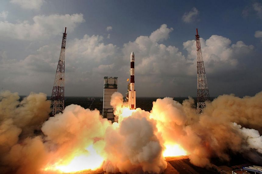 This handout photograph released by the Indian Space Research Organisation (ISRO) on Nov 6, 2013, shows the PSLV-C25 rocket carrying the Mars Orbiter Spacecraft blasting off from the launch pad at Sriharikota on Nov 5, 2013.India's Mars spacecr