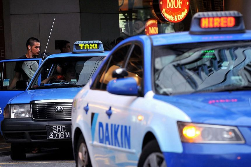 The Government will relook the taxi fare structure to make it simpler and easier to compare across cab operators, said Senior Minister of State for Transport Josephine Teo. -- ST FILE PHOTO:NG SOR LUAN