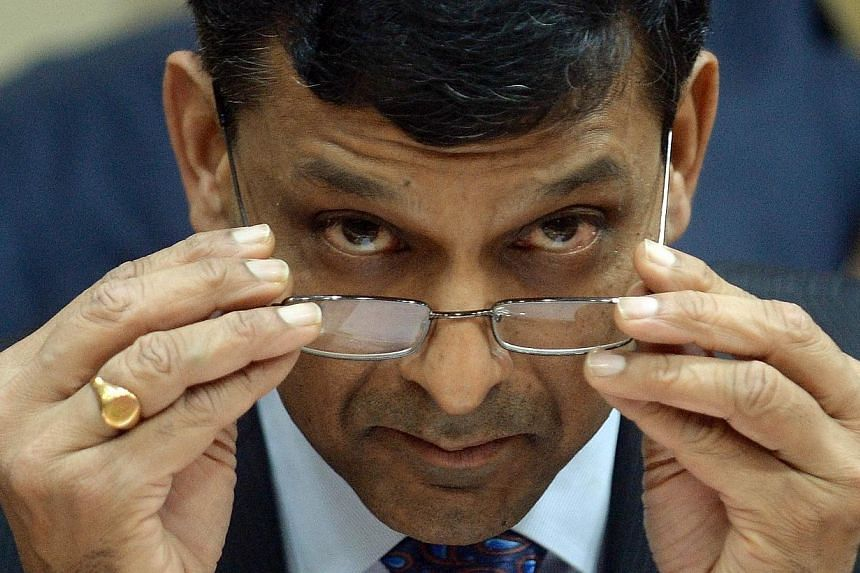 Reserve Bank of India (RBI) governor Raghuram Rajan pausing before his meeting bankers at RBI headquarters in Mumbai on October 29, 2013. India's new central bank governor hiked the key interest rate for a second month running, disregarding calls for
