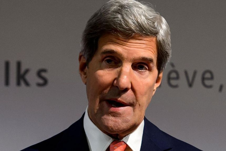 United States (US) Secretary of State John Kerry gestures during a press conference closing three days of talks on Iran's nuclear programme in Geneva on Nov 10, 2013. US lawmakers will wait for a briefing by Mr Kerry this week before deciding whether
