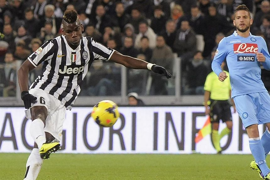 Juventus' Paul Pogba (left) shoots to score a third goal against Napoli during their Italian Serie A soccer match at the Juventus stadium in Turin on Nov 10, 2013. Juventus have been ordered by Serie A officials to play their next two home games with
