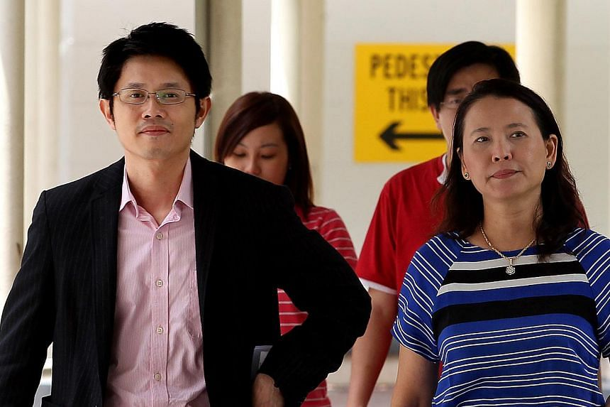 Jim Wong Meng Hang (left) and Zhu Xiu Chun, the two doctors involved in the 2009 death of a patient following liposuction treatment in their clinic, were charged on Wednesday, Nov 13, 2013, in a district court for improper procedures. -- ST FILE PHOT