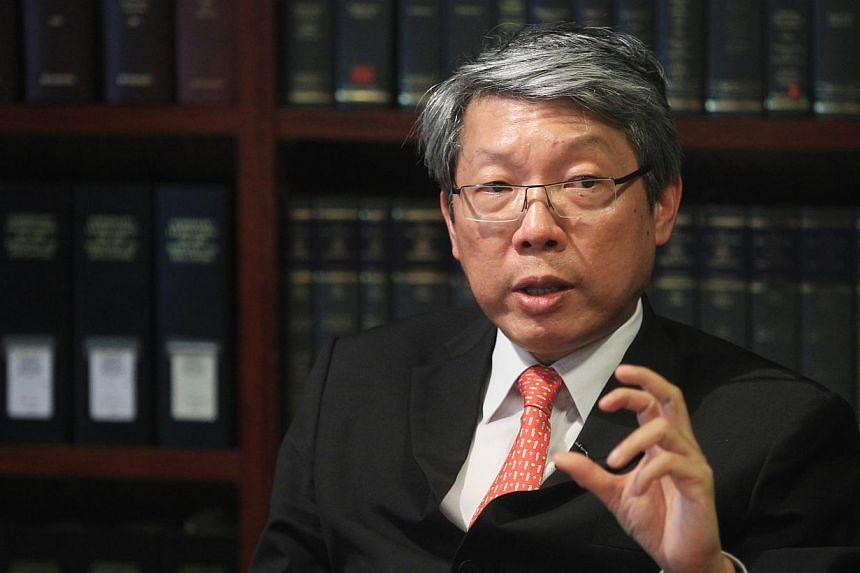 Senior Counsel Lok Vi Ming (above) has been re-elected president of the Law Society for a second year term, the society said in a statement on Wednesday, Nov 13, 2013. -- FILE PHOTO: ZAOBAO