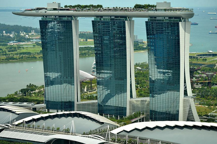 The Marina Bay Sands (MBS) hotel resort is seen from the Ocean Financial Centre on Nov 7, 2013.Casino regulators have imposed more than $500,000 worth of penalties on the two casino operators here for various breaches between May and December 2