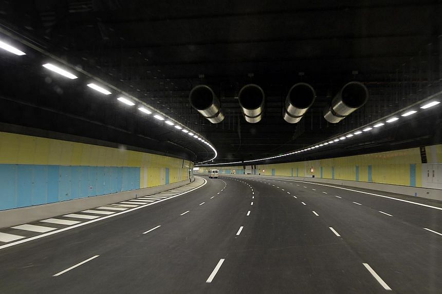 Sneak peek at Singapore's first undersea road tunnel at the Marina Coastal Expressway, slated to open on Dec 29, 2013. -- ST PHOTO:DESMOND FOO