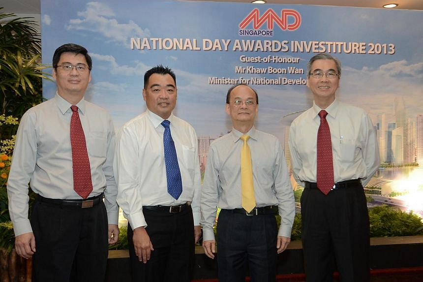 (From left) Mr Cheng Tai Fatt (BCA), Mr Quek Ser Bock (HDB), Mr Lam Siew Wah (BCA), and Mr Lim Eng Chong (URA) at the MND National Day Awards Investiture 2013on Wednesday, Nov 13, 2013.They were among 93 MND officers who received awards.