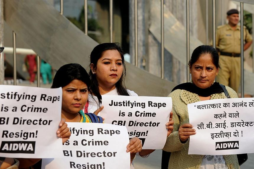Indian demonstrators hold placards during a protest outside the Central Bureau of Investigation (CBI) headquarters in New Delhi on Wednesday, Nov 13, 2013.India's top federal police officer apologised on Wednesday after being condemned by women
