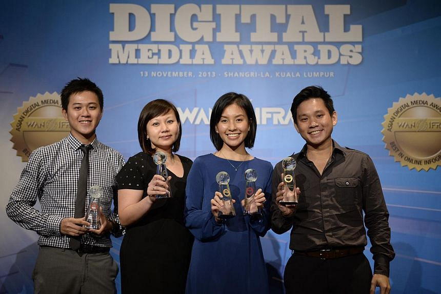 (From left) Mr Desmond Lim, photographer from The Straits Times (ST); Ms Ong Hwee Hwee, assistant news editor from ST; Ms Nurulnadiah Md Noh, content producer from ST online; and Mr Kenneth Tan, webknowledgist from Stomp, at the 2013 Asian
